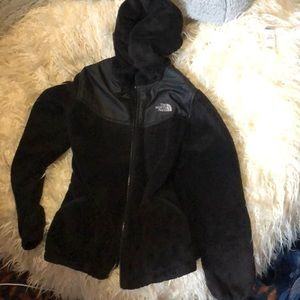 Fuzzy black hooded north face jacket